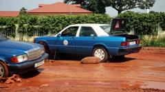 Africa repairing car street city Guine Bissau Stock Footage