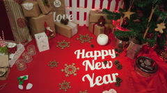 """Christmas composition with gift box and decorations and text """"Happy New Year"""" Stock Footage"""