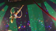 Girl spins on hoop in the circus Stock Footage