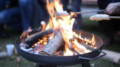 Grill pan with bread on a stick Stock Footage