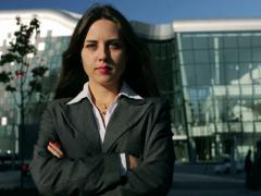 Businesswoman cross arms and doing serious look to the camera, steadycam shot Stock Footage