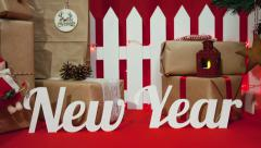 "Christmas composition with gifts, little white raft on the text: ""New Year"" Stock Footage"