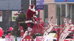 Christmas holiday town festival with carolers and horse drawn carriage Stock Footage