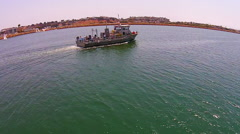 CHARTER FISHING BOAT LEAVING A HARBOR.  AERIAL VIEW. Stock Footage