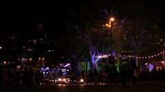 Carousel,crowd,trams,lights,cars traffic and windows at Christmas time Stock Footage