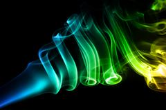 Multicolored smoke on black Stock Photos