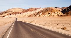 lonely car long highway badwater basin death valley - stock photo