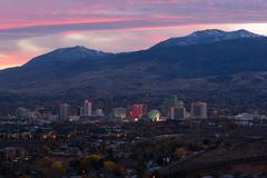 reno nevada gambling city evening sunset skyline sunflower mountain - stock photo