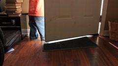Toddler stands inside open doorway Stock Footage