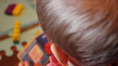 Close-up of a little boy playing in his room - stock footage