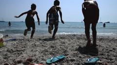 Kids running on beach - stock footage