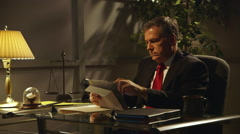 Businessman or lawyer working at his desk Stock Footage