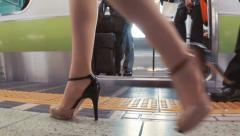 Business women and men board subway car in slow motion Stock Footage