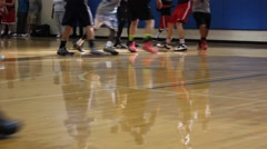 The feet of basketball players during a play Stock Footage