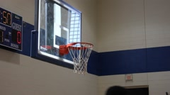 Basketball team shoots shots before a game Stock Footage