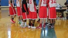Basketball team huddles together after game Stock Footage