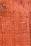 red painted rough wooden siding board - stock photo
