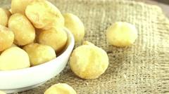 Rotating macadamia nuts (seamless loopable) Stock Footage