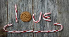 candy cane and gingerbread cookie spelling the word love - stock photo