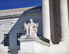us supreme court statue capitol hill washington dc - stock photo