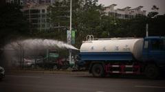 Urban green belt, sprinkler watering Stock Footage