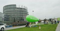 Preparing blimp in front of European Parliament Stock Footage