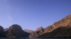 Moon over mountain lake. Panorama. Tajikistan, Iskander-Kul. TimeLapse. 1280x720 Stock Footage