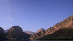 Moon over mountain lake. Panorama. Tajikistan, Iskander-Kul. TimeLapse Stock Footage
