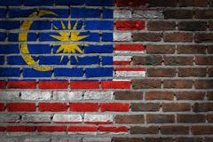 brick wall texture with malaysia flag - stock photo