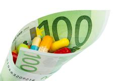 tablets and hundred euro bill - stock photo