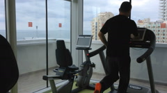Treadmill in a gym with seaview Stock Footage