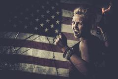 Punk girl against usa flag with brass knuckles and molotov cocktail Kuvituskuvat