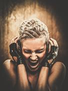 attractive steampunk girl with headphones - stock photo