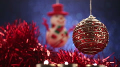 Christmas ball spinning on glitter blue background Stock Footage