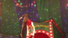 Balancing act performed by professional gymnast in the circus. Acrobat - stock footage