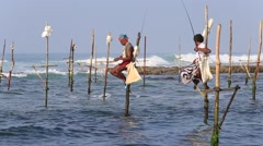 Local fishermen are fishing in unique style in Indian ocean water, Sri Lanka Stock Footage