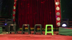 Greeen chairs in front of red curtains in the circus arena Stock Footage