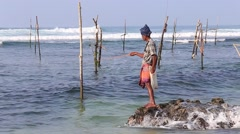 Local fishermen are fishing on the beach in Indian ocean water, Sri Lanka Stock Footage
