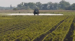 Agriculture toxic tractor spraying 2 Stock Footage