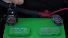 4K Man Charges Car Battery Close Up Stock Footage
