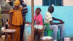 Africa woman selling peanuts Bandim street city market Bissau Guinea Bisseau Stock Footage