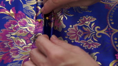 Seamstress Pleating Fabric Closeup Stock Footage