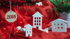Beautiful little houses on a red background - Christmas composition 2015 - stock footage