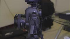 Pan up of a DSLR camera with the shot-gun mic Stock Footage