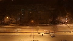 People walk at night in snow storm Stock Footage