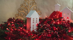 Beautiful Christmas composition with small house and garlands - stock footage