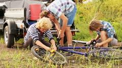 People Repairing a Bicycle Stock Footage