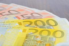 Close-up of 200 and 50 Euro banknotes on the table - stock photo