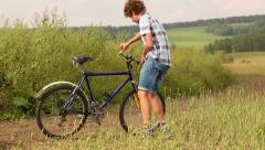 Boy With Bicycle Stock Footage