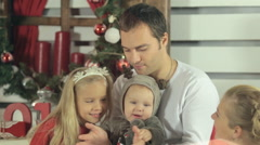 Beautiful happy family with cute baby dressed as a deer enjoyed - stock footage